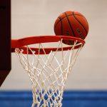 Basketball going into hoop