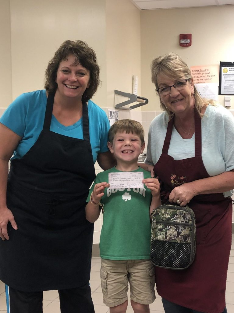 Cafeteria staff with a student